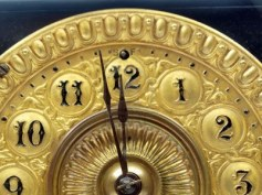 10739761-close-up-of-the-minute-hand-of-a-black-and-gold-antique-mantle-clock-about-to-strike-12-o-clock[1]