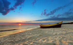 sunset-on-the-beach-desktop-wallpaper-sand-boats[1]