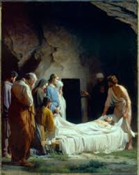 laying jesus in the tomb