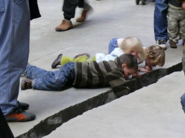 Children peering into the shibboleth at the Tate Modern in London