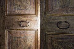 old-wooden-door-opening-light-shining-33999556