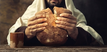 The Last Supper Jesus breaks the bread.