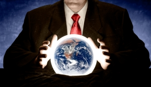 A man is consulting a crystal ball to foretell the future of planet Earth. Earth image courtesy of NASA http://earthobservatory.nasa.gov/